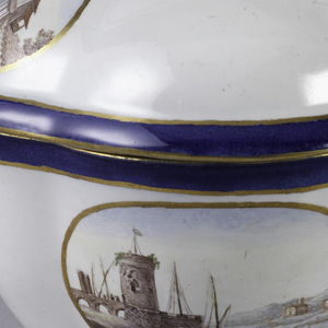 Four-lobed oval plan with curved walls. Four-lobed dome cover with knob shape of a hip and leaf. Blue-gray body. Bowl and cover each decorated with two oval medallions with polychromed harbor scenes and ruins. Wide blue and narrow gold bands and edges.