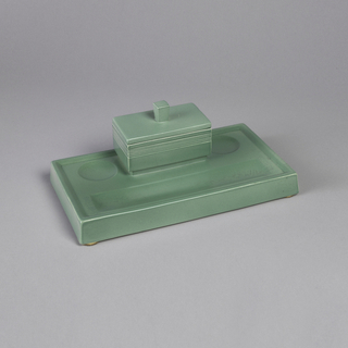 Green earthenware rectangular inkwell, with indentation for pens and inkwell with lid.