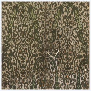 Similar wallhanging used in two rooms in Winterthur Museum, Delaware (1955). Has been folded under along top and cut to fit about a ceiling beam. Has been moth-eaten, and perforated with nail holes. Small stylized floral motif set within tracery, printed in green flock and orange pigment, on natural-color ground.
