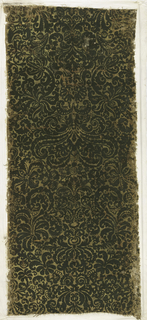Symmetrical non-repeating design, in close arrangement, of foliate and floral forms. Dark green flock on gold.