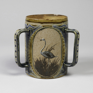 Three handled stoneware tankard with glazed and incised ornament in shades of blue and olive enframe three ovals.  Within each oval a blue flamingo is modeled in relief against a stippled ground, light buff, each flamingo stands in brown grass.
