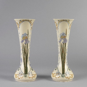 One of a pair; vase with bulbous base and flared opening. Decorated with violet and white calla lilies with tall green leaves, framed by yellow foliage.
