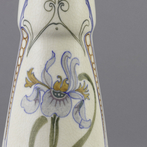 Vase with wide base and narrowing at the top. Decorated with violet and white calla lilies with tall green leaves, framed by blue lines, with yellow fan motif.