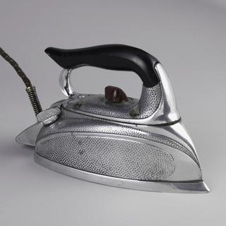 Large metal body surmounted by black-painted wood handle.