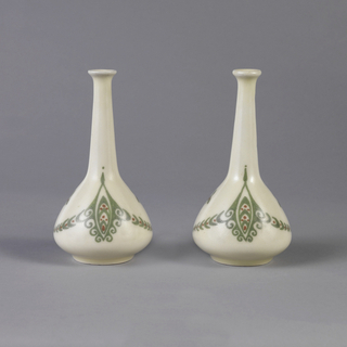 One of a pair; vase with bulbous vase and narrow neck leading to a flared opening. Decorated with green and red symmetrical foliage motifs on white ground.