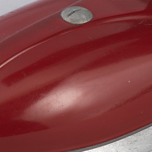 Red iron with metal base surmounted by a black handle cloth cord attached at top rear.