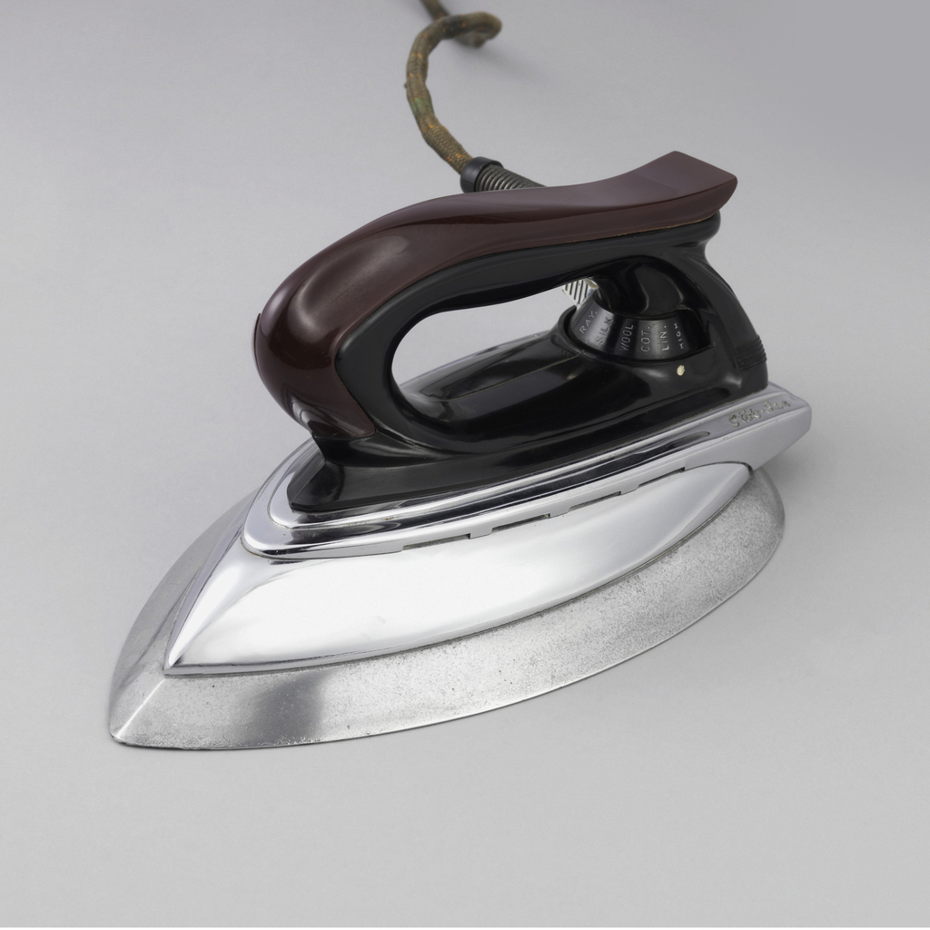 Metal body surmounted by brown and black plastic handle.