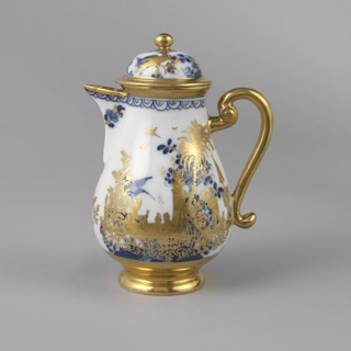 Pear-shaped, on rounded flaring circular foot; scrolled handle, simple triangular spout, domed cover with flat circular finial. Solid gilding on foot, handle, lip, edge of pot and of cover, and finial. Underglaze decoration of floral sprays and birds; overglaze gilding representing a Chinoiserie scene of figures in landscape. Edge of pot and of cover mounted in gilded brass.