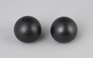 Globular form with three holes at the top.  Decorated in a matte black finish.