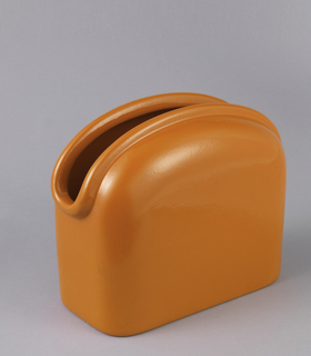 Vase with upright rectangular shape. Flat base with upright straight sides curving inward to form sloping shoulder. Opening of vase is shaped like elongated oval with molded lip surround. Glazed brilliant orange inside and out.
