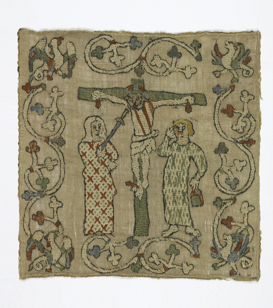 Fragment from an altar frontal in coarse cream-colored linen embroidered in silk in red, light green, light blue, and white. In the center field, the Crucifixion: Christ on the cross with bowed head, with blood dripping from the hands and three red cuts across the body. A figure appears on each side, possibly St. John the Baptist on the right and Mary with a sword at her breast on the left; both figures wear long straight robes with simple geometric patterns. Christ's face appears to be re-worked, and that of St. John is very worn. With a deep border of curving vines with three-lobed leaves. At corners are winged beasts with tails (wyverns).