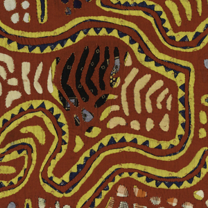 Mola panel of reverse appliqué in an almost symmetrical pattern; a center circle is connected to a circle in each corner with long, curving arms. A cross appears in the center of each circle. Surrounded by small circular cut-outs. The predominant colors are red and yellow; printed cottons are used behind the cut-outs.