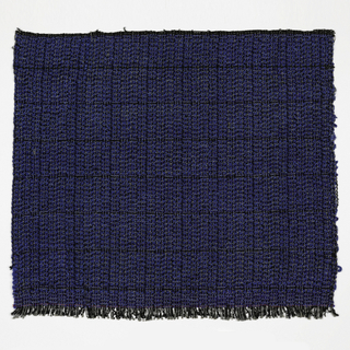 Hand woven sample in blue with a 2 inch square black grid.