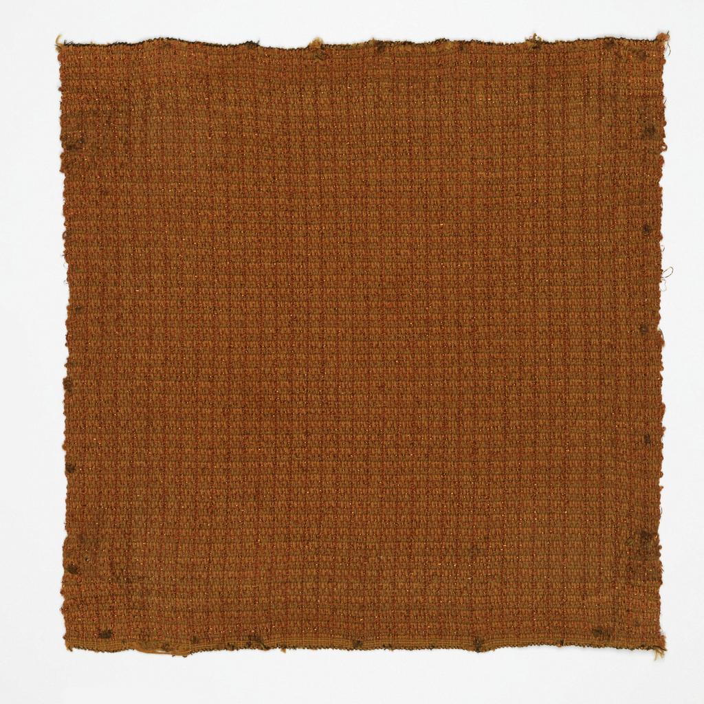 Hand woven sampel in predominantly bright orange.