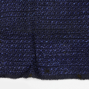 Hand woven sample in blue fabric with texture due to a variety of yarns.