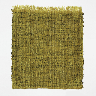 Hand woven predominantly yellow and black fabric with mottled effect caused by color and texture.
