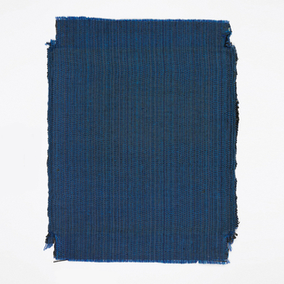 Hand woven sample of predominantly blue textured surface.