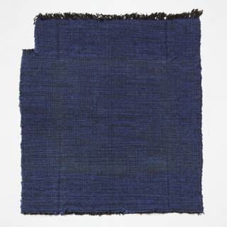 Hand woven brown, olive and black warp and blue boucle weft producing an overall effect of textured dusty blue.