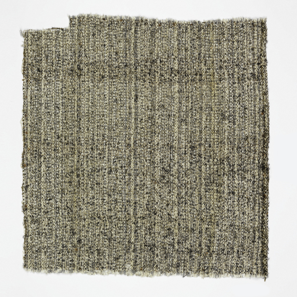 Hand woven textured fabric with a predominantly grey effect.