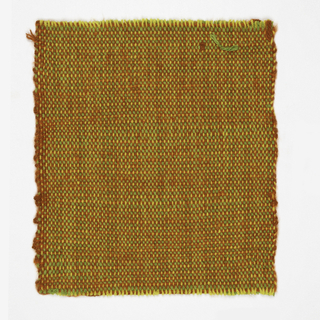 Hand woven bright fabric created with green orange and yellow yarns.