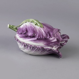 Tulip laid horizontally, with upper and lower portions of dish composed of full length petals.