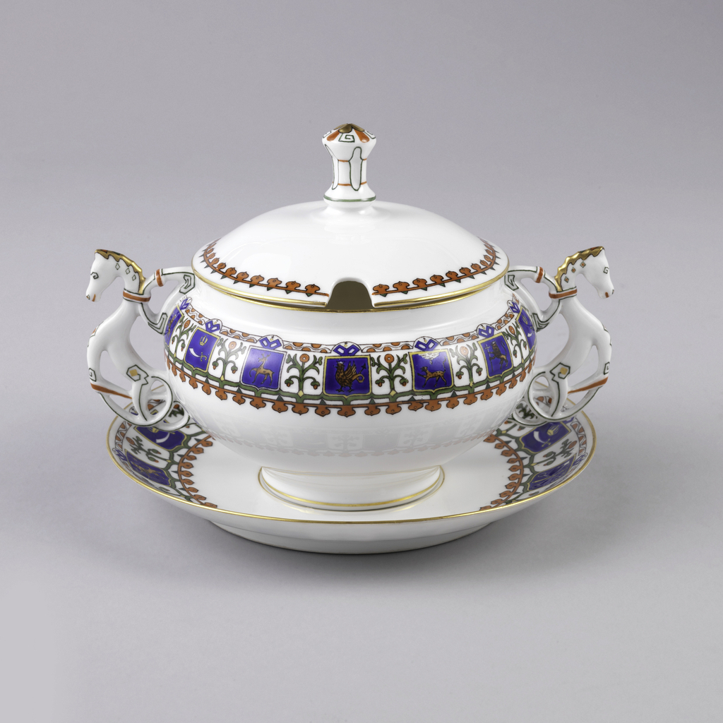 Bulbous bowl with straight short neck and conventionalized horses for handles.  Cover with shaped knob and cut-out for spoon.  Slightly curved saucer. The bowl and saucer have a row of shields with animals on blue field and conventionalized flowers in between.