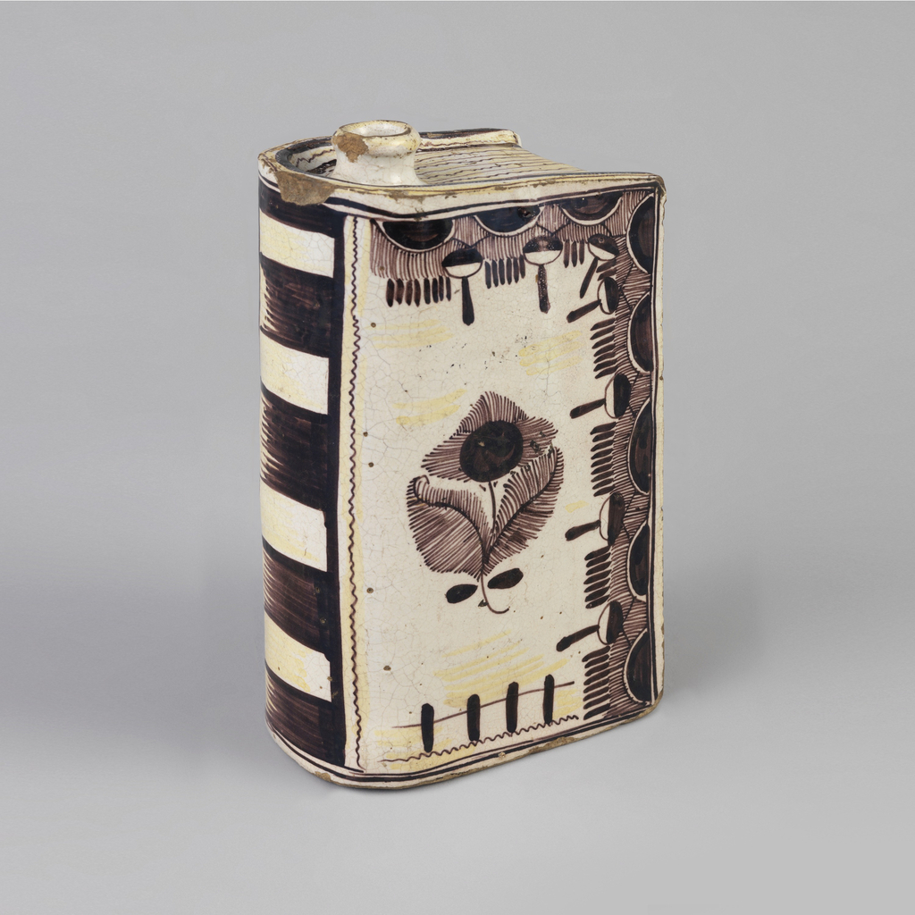"Book-shaped flask with short circular neck and mouth at top, near ""spine""; the whole decorated in brown glaze on a white ground, depicting book elements: front ""cover"" decorated with brown floral and tassel motif; ""spine"" with horizontal bands of brown and white; the top with brown lines denoting ""pages."""
