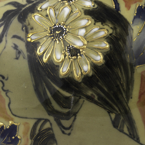 Footed bulbous face with small trumpet mouth. Decorated with painterly image of a woman with head in profile, wearing white daisies in long black hair and white dress, part of collar visible. Around her is foliated landscape.