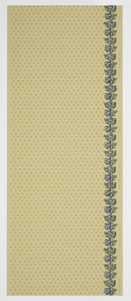 All-over pattern of small diamond shapes in light brown; on right side, ascending blue vine, printed on beige ground.