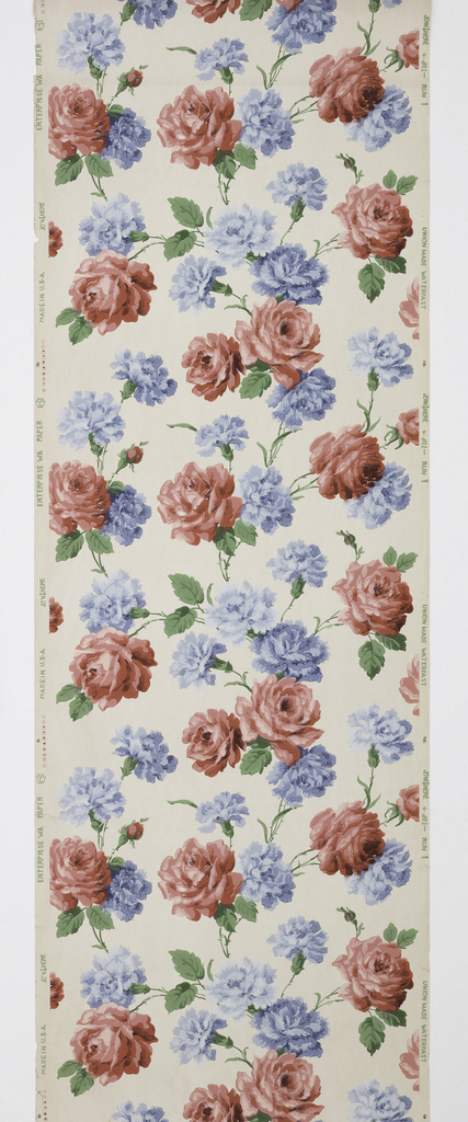 Large all-over pattern of red roses with blue carnations on white ground.