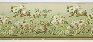 Flitter frieze with acanthus leaves framing sprays of large roses and leaves. Background: Celadon blending into a darker green. Design printed in forest green, olive, pink, rose, coral, white, umber, metallic gold and gold mica flakes.