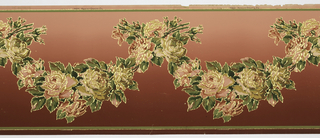 Flitter frieze with design of leafy swags with large roses and rosebuds. The top and bottom edges have a narrow stripe as the border. Printed in pinks, greens, tan and gold mica flakes on a background that shades from deep pink to a lighter shade of pink.