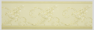 A scrolling acanthus leaf and flower design, repetitive in a wave-like formation on a cream ground with one rinceau border. Printed in cream, beige, gray, mica and gilt.