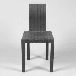 Black rectilinear form with curved edges, composed of ten consecutive L-shaped modular units configured to form seat, back,  and legs.