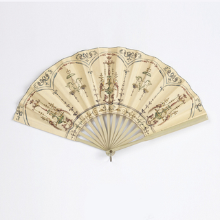 Folding fan. Paper leaf has an ink and watercolor grotesque design of neoclassical elements including symmetrical fountains with birds and hanging baskets of flowers, framed with arches and bowknots at the top. The reverse is undecorated. Wooden sticks painted pale blue.