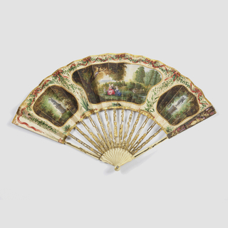 Pleated fan. Paper leaf gilded and painted in watercolor, showing three medallions (two of statuary and trees, third of three ladies and three cupids in landscape), border of painted red bows. Carved ivory sticks.