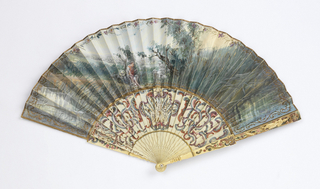 Pleated fan. Parchment leaf gilded and painted with gouache. Obverse: rustic landscape with figures: a crowned and enthroned man; a woman standing, crowned. Reverse: landscape with sheep and shepherd. Pierced, carved and painted ivory sticks with rococo scrolls and figures. Carved figure on guards.