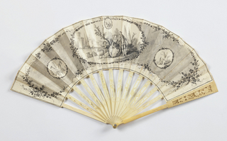 Pleated fan. Parchment leaf painted with gouache in grisaille. Obverse: a large central cartouche showing figures in a landscape with sheep; a small cartouche at left with musical trophy and at right with putto; floral border. Reverse: landscape showing figure and small floral spray. Pierced and carved ivory sticks. Rivet is set with a faceted stone.