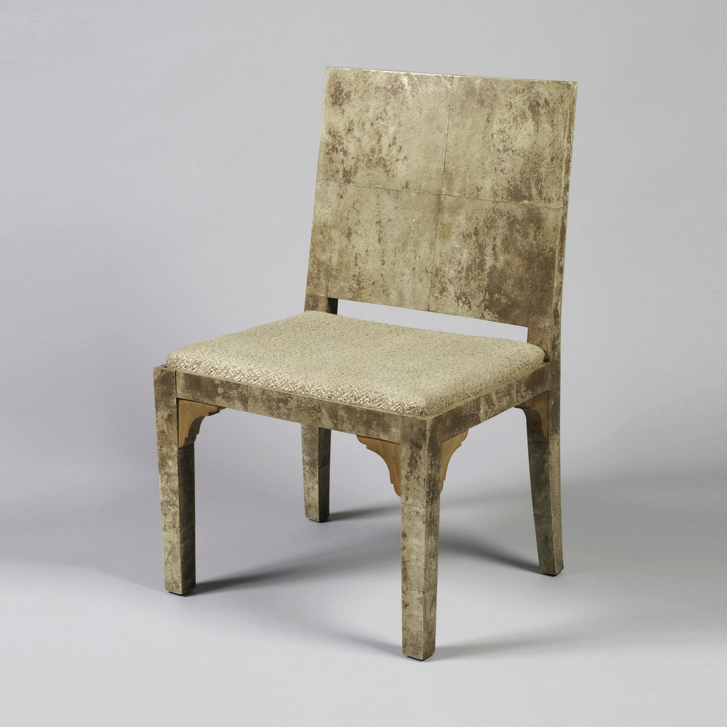 Square wood frame covered with mottled beige and tan shagreen; solid, slightly curved square back tapering slightly toward rear; square seat upholstered in woven tan fabric.