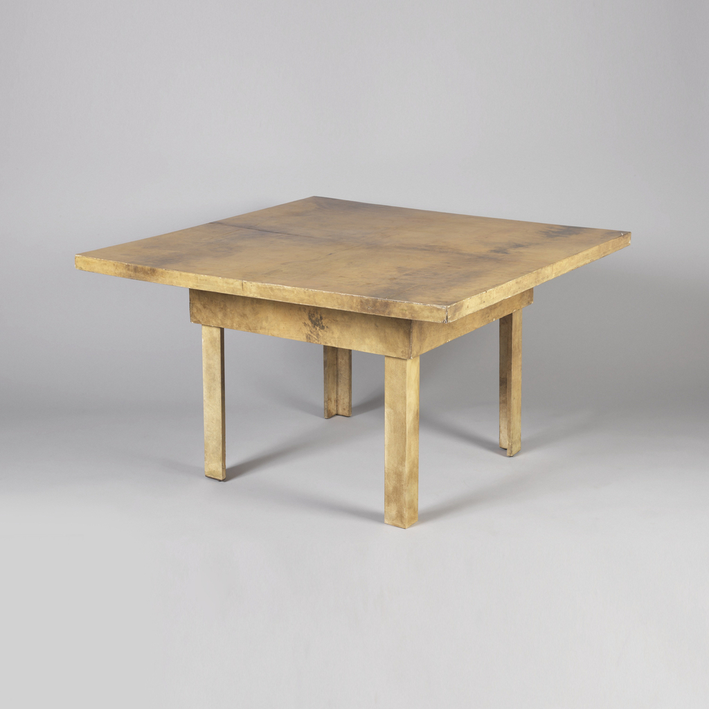 Parchment-covered top to fit over coffee table.