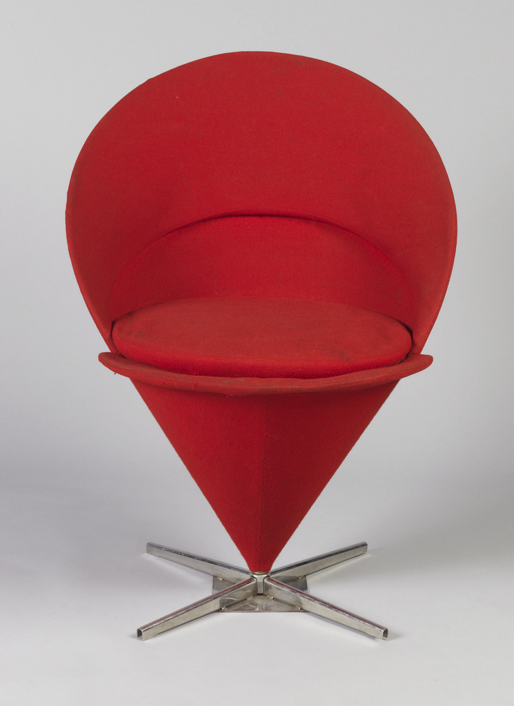 Red chair supported on four horizontal prong-like steel feet; base of chair in form of inverted cone rising at seat to form curved circular back rest; separate circular seat cushion. Woven wool upholstery over foam padding.