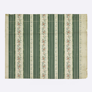 Full width, giving slightly more than one repeat. Bands composed of wide green and narrow white stripes, enclosing alternating white bands set with wide and narrow serpentine vines with flowers.