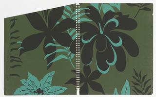Stylized large-scale flower and palm leaf motifs scattered irregularly on dark olive-green ground; the motifs are all unique; some of the motifs are black and others bright blue; occasionally the black motifs are highlighted in blue and vice versa.