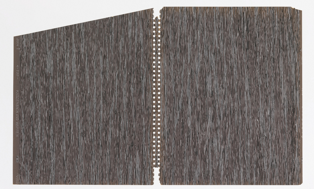 Faux bois or imitation woodgrain pattern; white and black striations over larger stripes of gray on charcoal gray ground.