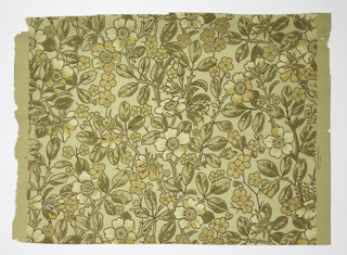 All-over vining floral pattern. Printed in shades of green, white and metallic gold on pale green background.
