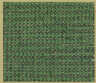 Woven sample of grass green chenille with gold metallic effects. The warp alternates a paired light and dark green cotton with a thick, soft plied dark green cotton. The weft is green chenille and flat gold metal strips with occasional gold-wrapped silk-core yarns laid in with the flat one. The paired warps operate in plain weave; the single warps go over two and under one weft.