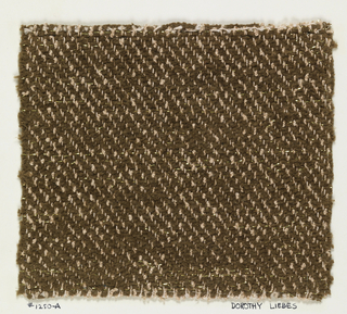 Woven sample mounted to a cardboard card with notations by the designer. Overall brown and pink tweed effect, with warps of alternating pink cotton and pink rayon or mercerized cotton bouclé, and wefts of brown chenille. Very narrow gold strips be introduced at random in the weft.