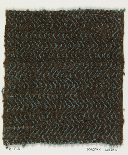 Woven sample mounted to a cardboard card with notations by the designer. Brown chenille with a vertical zigzag design in turquoise bouclé. Warps are turquoise cotton bouclé; wefts are brown cotton chenille.