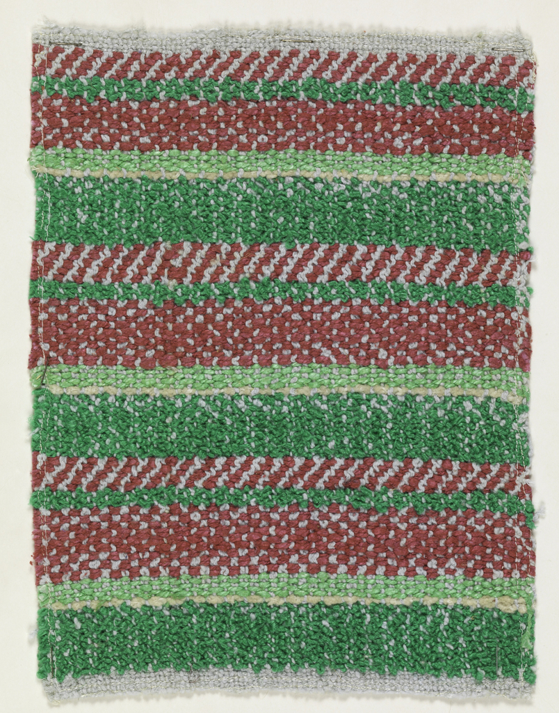 Woven sample mounted to a cardboard card with notations by the designer. Horizontal stripes of varied widths in medium and light green, tan and red. Warp is light gray cotton; wefts are bright green bouclé, light green plied yarn, red and tan cotton chenille.