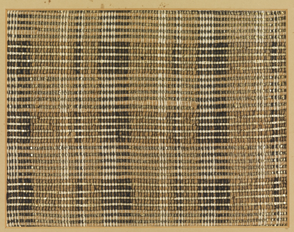 Handwoven sample with very subtle plaid in black and white cotton, natural jute and gold metallic. Warp has bands of thin white cotton, thick white cotton, thin black cotton, and thick black cotton. Weft alternates jute and gold metallic strip, which is doubled and is occasionally twisted or overlapped for an irregular effect.
